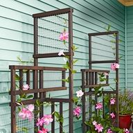 Build a trellis that becomes even more beautiful when intertwined with climbing plants.