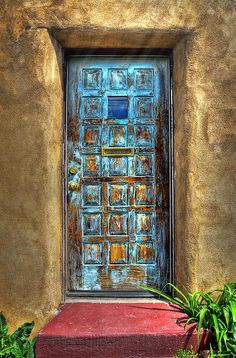 You see a lot of blue doors in Santa Fe, New Mexico. I like how this door is chippy and faded blue instead of perfect paint. The colors together are wonderful. Cool Doors, Unique Doors, Knobs And Knockers, Door Knobs, When One Door Closes, Door Gate, Painted Doors, Closed Doors, Doorway