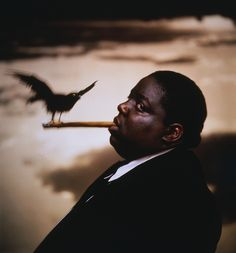 the Notorious B.I.G. paying Homage to Alfred Hitchcock's classic photo by Phillipe Halsman.. Source