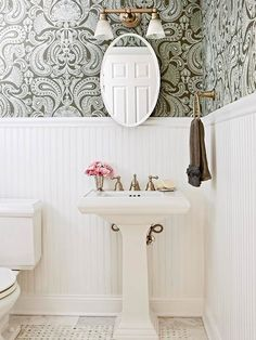 I love the bead board and wallpaper in this bathroom.  We are redoing our half bath and while it is smaller, are going for a similar look.  I really wanted green wallpaper and am partial to paisley.  I found a spa-blue print that was affordable so I just hope I like it as much...