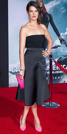 Last Night's Look: Love It or Leave It? | COBIE SMULDERS | Also at the L.A. premiere of Captain America: The Winter Soldier, the actress adds some color to her strapless black top and flirty satin skirt (both Stella McCartney) via hot-pink accessories and a bold pout.