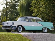 1956 Oldsmobile 88 Holiday Two-Door Hardtop   Senior picture idea -- backdrop for pictures