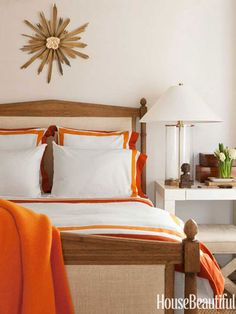 Orange bedding accents brighten a guest room in a San Francisco row house.