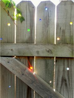 Glass marbles in your fence.  Love!  brilliant!