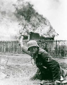 "Wehrmacht soldier throwing a ""potato masher"" -Operation Barbarossa. German Soldiers Ww2, German Army, Luftwaffe, World History, World War Ii, Operation Barbarossa, Germany Ww2, German Uniforms, War Photography"