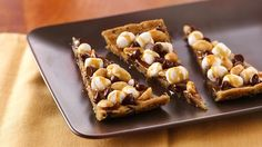 Rocky Road Cookie Pizza recipe and reviews - Classic rocky road ingredients--chocolate, marshmallows and peanuts--top a tender cookie crust in an out-of-this-world decadent dessert.