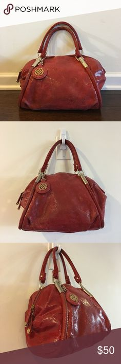 """Antonio Melani Red Leather Satchel Handbag - M Antonio Melani Red Leather Satchel Handbag - Size Medium Exterior have sign of use, most on the strap drop (photo 7) - Good condition Interior is Excellence condition and Clean Product code: #58909 Brand: Antonio Melani Style: Satchel Material: Leather Size; Medium Color: Red Closure: Zipper Bag Height: 11"""" Bag Depth: 5"""" Bag Length: 12"""" Strap Drop: 5.5"""" Country/Region of Manufacture: China ANTONIO MELANI Bags Satchels"""