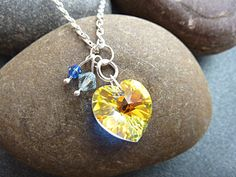 Swarovski crystal heart necklace on a silver plated chain. This is a very pretty yellow Swarovski (aurora borealis) crystal heart pendant