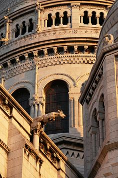 Gargoyle - Sacre Coeur - Paris - France  Two-fold purpose. Onr to carry rain off of the roof and two to be menacing to people or monsterous beings, evil spirts.
