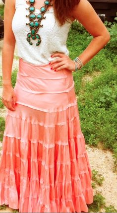 squash blossom necklace and maxi skirt