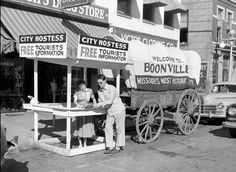 ) photo by Gerald R. Massie of a tourist stopping for information at the Boonville ('Missouri's Most Historic City') Hostess Wagon on Main Street in front of Hirsch's Drug Store. (Public-domain photo via the Missouri State Archives) Boonville Missouri, 1940s Photos, Drug Store, Historical Images, My Town, Public Domain, Old Pictures, Main Street, History