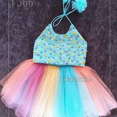 Material: Baby pink tulle frock with ivory tulle skirt Below knee length dress Zipper back closure for easy dressing Cotton lining for comfort Baby Girl Dresses Diy, Kids Party Wear Dresses, Baby Girl Frocks, Frocks For Girls, Blue Dresses For Kids, Birthday Frocks, Baby Girl Birthday Dress, Baby Frocks Designs, Kids Frocks Design