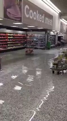 FEROCIOUS thunderstorms flooded supermarkets, submerged cars and turned tram…
