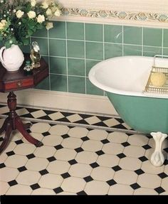 love the black and white tiles and painted clawfoot vintage bathroom