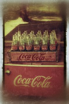 old wooden case---painted yellow with red lettering----also old cooler---bottles I think are newer1