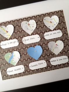 "Little heart map cutouts of personal places like; first home, best vacation and first ""I love you"". such a cute gift!"