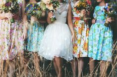 Bridesmaids in colourful, floral, 1950s style dresses. A Euroa Butter Factory Wedding: Tash Paul