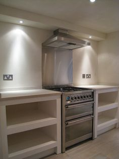 A wooden frame was clad in Bluclad to form new kitchen units which were then finished in our Moroccan plaster and a grease-resistant sealer. Kitchen And Bath, New Kitchen, Kitchen Interior, Kitchen Design, Kitchen Bookshelf, Diy Kitchen Storage, Grey Kitchen Cabinets, Kitchen Units, Concrete Kitchen