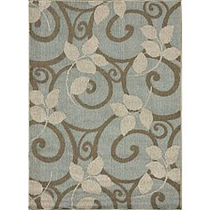 A unique floral pattern highlights this machine-made polypropylene rug. This area rug is great for both indoor and outdoor use and features shades of blue, brown and beige.