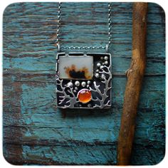 designed with imagination and love, 100% built with hands, sterling silver 925, a dendritic agate and a carnelian cabochon.    pendant size,
