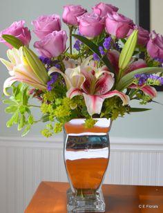 Lavendar rose flower arrangement in silver vase