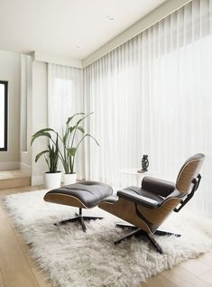 Modern reading nook with Eames lounge chair and flokati rug. Designed by Johnson Interior Design. Furniture, Interior, Home, Flokati Rug, Eames Lounge Chair, White Flokati Rug, Wood Mantels, Interior Design, Furniture Design