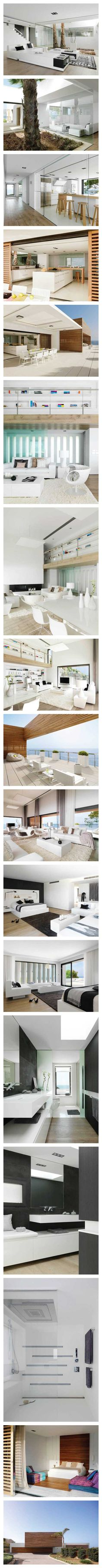 Pure White by Susanna Cots Barcelona-based designer Susanna Cots designed the interior of this cliff side house in Almuñecar, Granada that she calls Pure White. The main color of the house is obviously white, for it's the sum of all colors of light. With its location right by the ocean, the house is bombarded by natural light making white seem like the perfect starting point for the design.