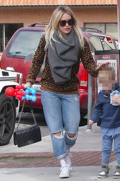 Hilary Duff wearing Chanel Pre Fall 2012 Bag, A.L.C. Tatum Sweater, Converse All-Star High Tops White and Karen Walker Number One Sunglasses
