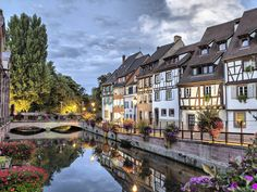Walt Disney would surely approve of Colmar, with its timber-framed houses, colorful facades, and flower-lined canal. The commune is a delight to take in, whether its strolling the cobblestoned streets or taking a canoe trip down the water. Along with Kayersberg and Strasbourg, this provincial town is a trademark of the beautiful and charming Alsace region, located in northeastern France near Germany and Switzerland.