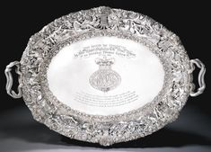 PRESENTATION FROM H.R.H. THE PRINCE REGENT TO GENERAL THOMAS GARTH, 2 MAY 1816  A George III silver two-handled tray, Paul Storr for Rundell, Bridge & Rundell, London, 1815, after designs by Thomas Stothard