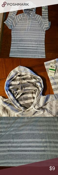 American Rag young mens hoodie pullover American Rag size large young mens hoodie, drawstring hoodie, front pocket, lightweight, gray & white, new with tags, 60%cotton/40% polyester. American Rag Shirts Sweatshirts & Hoodies