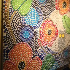 Bottle cap mosaic made by kids