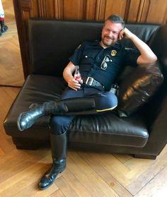 Cop uniform with tall black boots. Cop Uniform, Police Uniforms, Men In Uniform, Biker Leather, Leather Men, Leather Hoodie, Hot Cops, Bear Men, Military Men