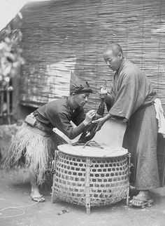 Men in Costume, Tying Cormorant (Aquatic Bird) for UseIn Fishing. Early 20th century, Japan. Photography by Seko Yasutaro. Smithsonian Institution, Freer Gallery of Art and Arthur M.Sackler Gallery Archives