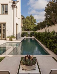 Fabulous Mediterranean patio features in a narrow in-ground pool fitted with stairs next to a hot tub.