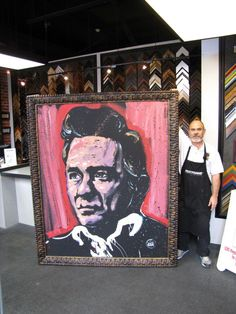 Definitely one of the coolest things we've framed! A six foot, 3 inch portrait of Johnny Cash painted on canvas using a Roma Moulding frame. — at FastFrame of LoDo.