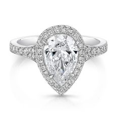 Pear ring 2 - Halo ring with Forevermark pear shaped brilliant diamond accented with white diamond melee in 18kt white gold.
