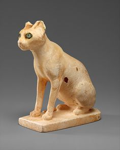 The cat first appears in painting and relief at the end of the Old Kingdom, and this cosmetic jar is the earliest-known three-dimensional representation of the animal in Egyptian art. | Cosmetic Vessel in the Shape of a Cat. Middle Kingdom, Dynasty 12, early, ca. 1990–1900 B.C. Egypt. Purchase, Lila Acheson Wallace Gift, 1990. Egyptian Egyptian alabaster (calcite) with inlaid eyes of rock crystal and copper.