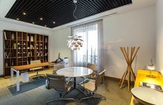 lamp made of round plates Madrid bank office shelf chairs