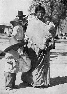Mexico - Mother carrying her toddler using a sling similar to the pouch.  National Geographic Magazine, Volume 31 (1917), page 559