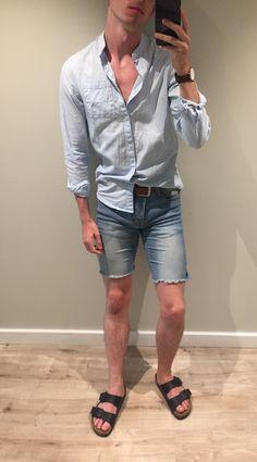 Blue striped shirt, cut off custom denim shorts, Birkenstocks and Daniel Wellington watch