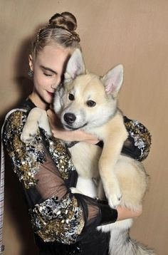January 26th: Cara with her dog Leo at Chanel Fashion Show 2016 in Paris, France