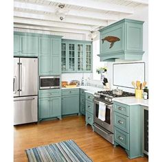 Light Blue Green Farmhouse Kitchen. A great way to add interest and color!