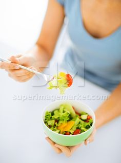 #woman eating #salad with #vegetables