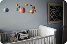 Baby boy's #nursery with solar system mobile.