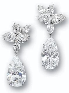 diamondsinthelibrary: Diamond pendant-earrings by Harry Winston. The cluster tops feature 10 diamonds which total approx 14 carats