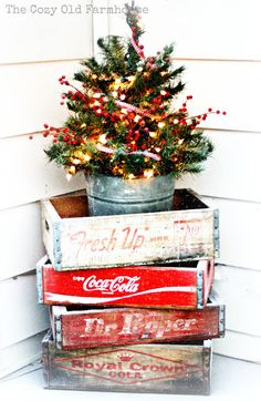 Farmhouse Christmas Vintage Decor - old quot; crates stacked to hold tiny tree - A Farmhouse Christmas - The Cottage MarketVintage Decor - old quot; crates stacked to hold tiny tree - A Farmhouse Christmas - The Cottage Market Noel Christmas, Merry Little Christmas, Rustic Christmas, All Things Christmas, Winter Christmas, Vintage Christmas, Christmas Crafts, Primitive Christmas, Primitive Crafts