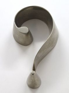 Surrealist nickel plated paperweight in the form of a question mark, III