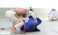 A reverse De La Riva (RDLR) guard sweep from world champion Michael Langhi. Langhi experiments with controlling the lapel with his left leg.