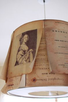 A clever DIY: enlarging the pages of old books and attaching them to a lamp.